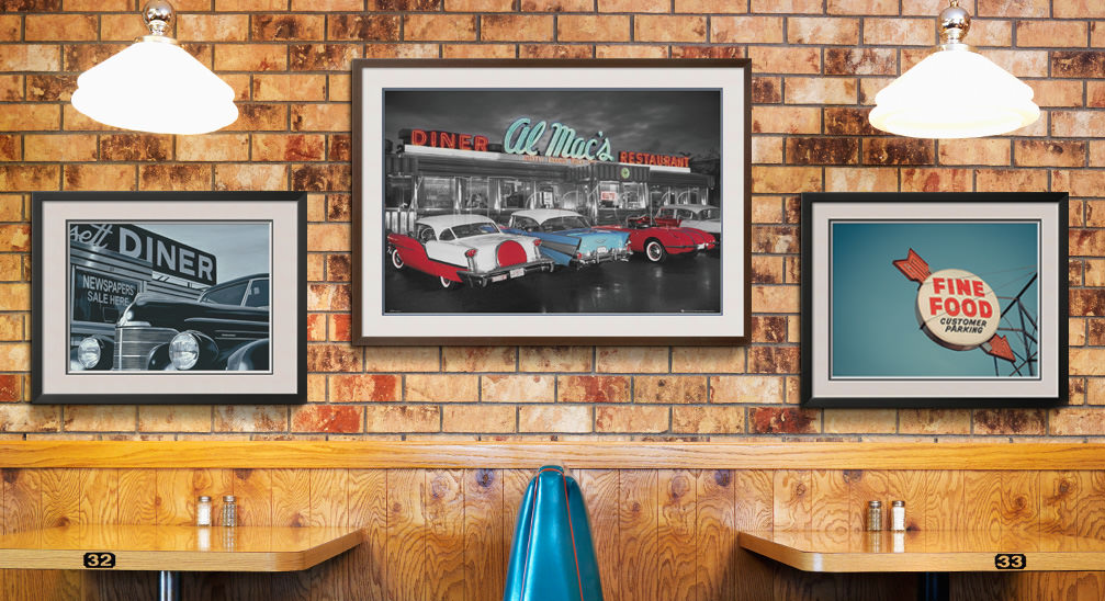 Framed abstract art and photo prints in a restaurant. Dining area décor to create a pleasant experience for foodies and diners.